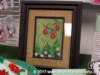 This framed art was quilled by Marianne Fassett
