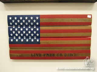 Garrick Ippolito made this wooden American flag from the center of a wire spool