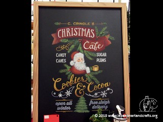 Sandra Dickau painted this Christmas Café sign