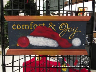 Sandra Dickau painted this comfort and joy plaque